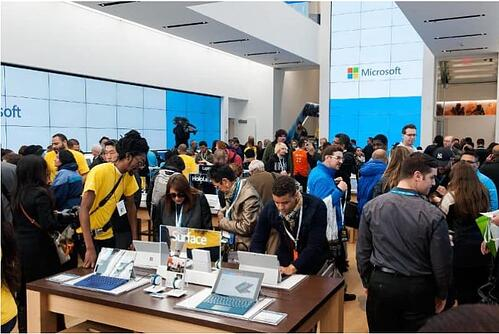 Customers look at merchandise at Microsoft's first flagship store