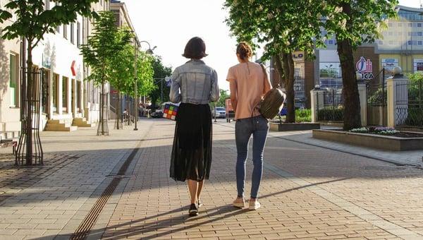 2 women walking side by side