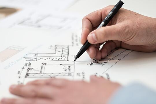 Interior designer drawing out a floor plan