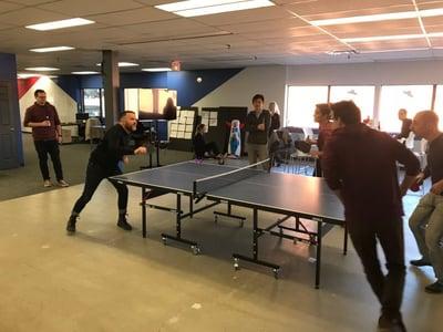 Yulio team playing ping pong